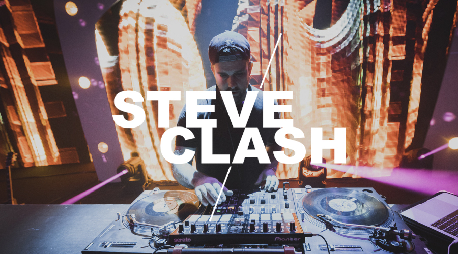 Steve Clash is DJing on a stage at a corporate Event in Berlin